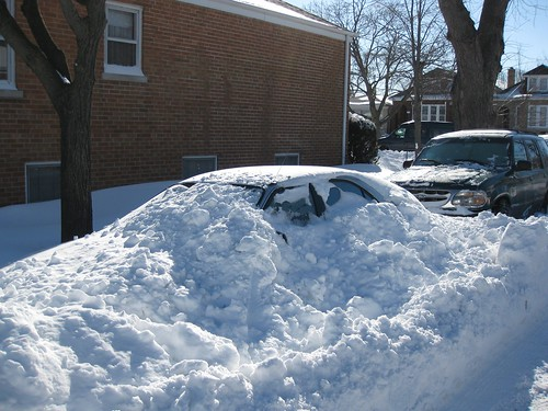 Car buried under lots of snow