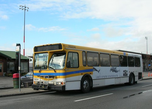 "TransLink bus R9254 at the Airport South terminus, signed ""C92 Bridgeport Stn"""