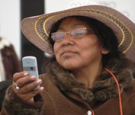 Woman uses her mobile phone to shoot video of a panel on Land Reform