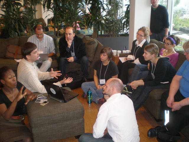 Photo of many different people working together in a discussion