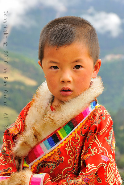 Yi Boy in Traditional Tibetan Coat