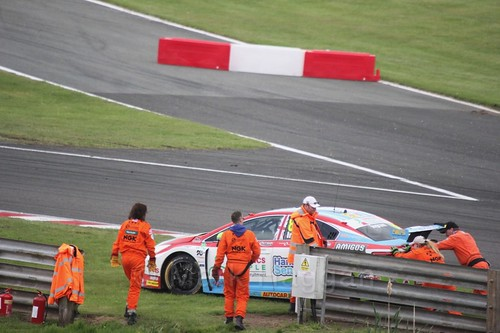 Marshalls help get Tom Ingram's stricken car off the track at Oulton Park, May 2017