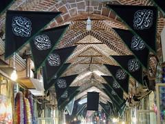 Black mourning 'Ya Hossein' flags in ancient bazar - Tabriz, Iran