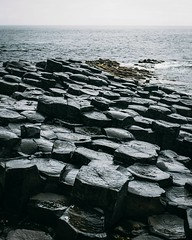 Day 694 The main reason people head to the Giant's Causeway: the surreal basalt columns. It was pouring rain while we were there which made for treacherous walking. I'm surprised there weren't more people falling. The worst I saw was a girl slip and accid