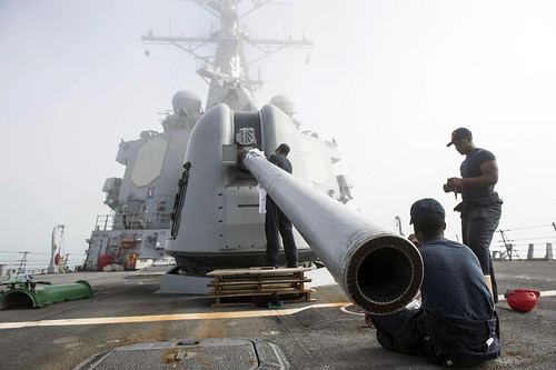Sailors+perform+maintenance+on+the+5-inch+gun+aboard+USS+Ross.
