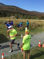 Punch drunk. Dan offering water at the starting line and Frank patting himself before his run.