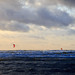A collection of kite surfers