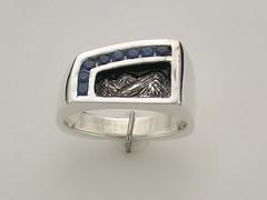 SS Mtn ring assymetrical w 8 channel Ceylon sapphire