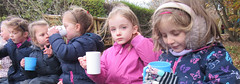 Red Class enjoying a warm drink at Forest School