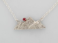 Detail View of Cont silver & 14ktwg Rockies necklace w 3.25mm Red Orange Sapphire