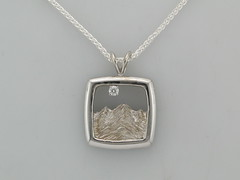 Cont silver & 14ktwg Rockies pend w 0.7 ct dia