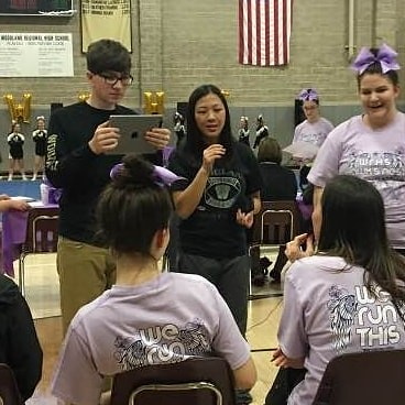 Our HHL broadcast crew--Jake Veillette, camera and Maddy Vallillo, reporter--interviews Woodland cheer coach, Amanda Wiener at the 2018 Hawks Nest Cheer Fest.