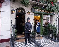 A policeman in front of Baker Street 221B