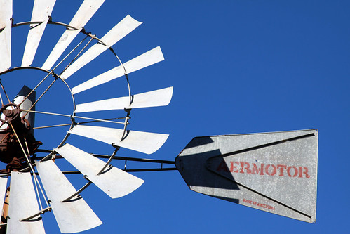 Windmill against a blue sky.