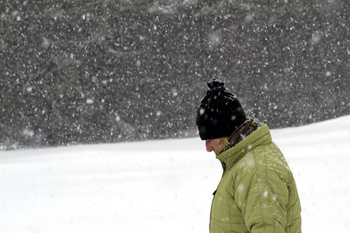 Woman hiking in snow storm