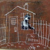 Banksy in Boston: Overview of the NO LOITRIN piece on Essex St in Central Square, Cambridge.