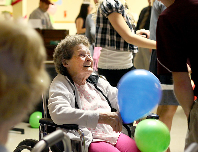 In her wheelchair with the balloons at her Care home
