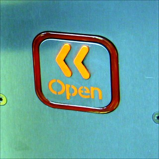 Photograph of button to open London Underground train doors.