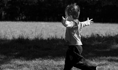 A young boy runs into someone's arms