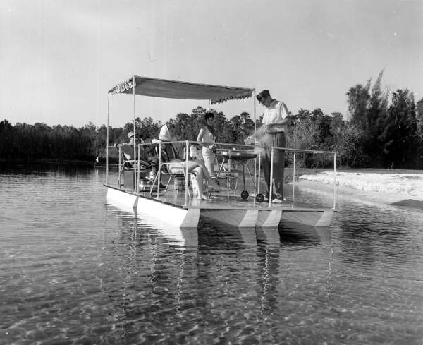 Barbequing on a pier boat: Weeki Wachee Spring, Florida