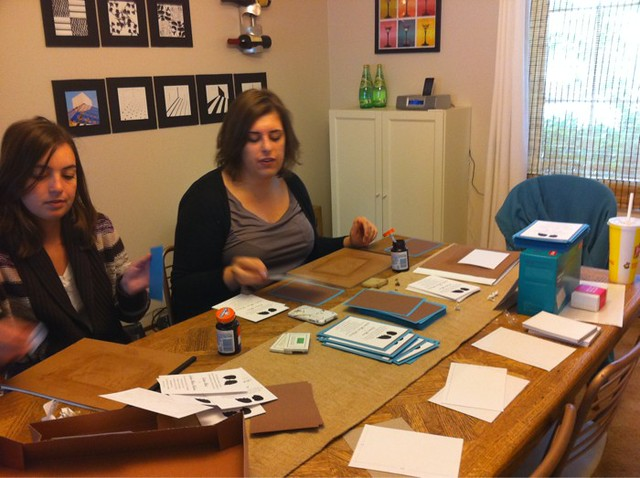 Assembling invitations!