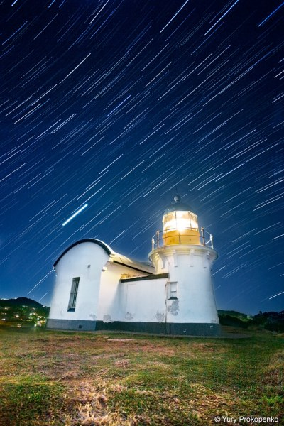 Star trails and light house
