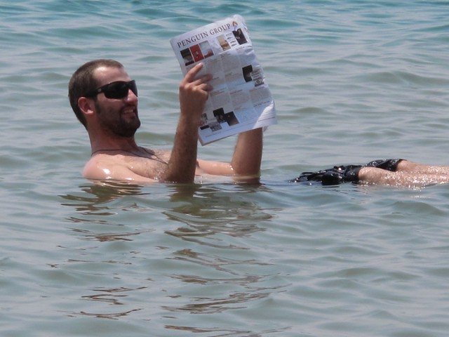 "obligatory ""reading newspaper in the dead sea"" photo"