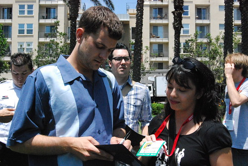 Pacey signing a script for me