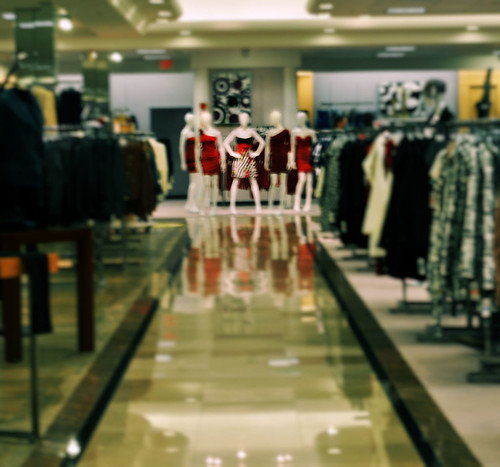 5 female mannequins out of focus in a large department store