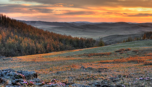 Spectacular sunset over forests, mountains and valleys in Mongolia