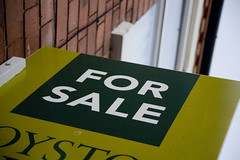 Green 'for sale' sign