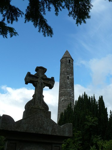 Tombstone and round tower at Glendalough