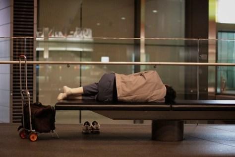 Man asleep in the Tokyo International Forum