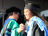 """Assistant Professor Ickes congratulates the grads. (photos by Cameron Rivera)  Leeward Community College celebrated spring 2017 commencement on Friday, May 12, 2017 at Tuthill Courtyard.  For more photos from Leeward Community College's spring 2017 commencement go to:  <a href=""""https://www.flickr.com/photos/leewardcc/sets/72157683964234296"""">www.flickr.com/photos/leewardcc/sets/72157683964234296</a>"""