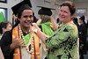 "Vice Chancellor Ardis Eschenberg ties the traditional kihei on grad Mateo ""Kepa"" Gelang.  Windward Community College celebrated spring 2017 commencement on Friday, May 12, 2017 at the Koolau Ballrooms and Conference Center.  View more photos at: <a href=""https://www.facebook.com/pg/windwardcommunitycollege/photos/?tab=album&album_id=1330704690344736"" rel=""nofollow"">www.facebook.com/pg/windwardcommunitycollege/photos/?tab=...</a>"
