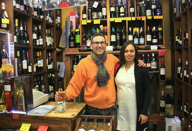 A friendly wine store owner at Girona Food Market