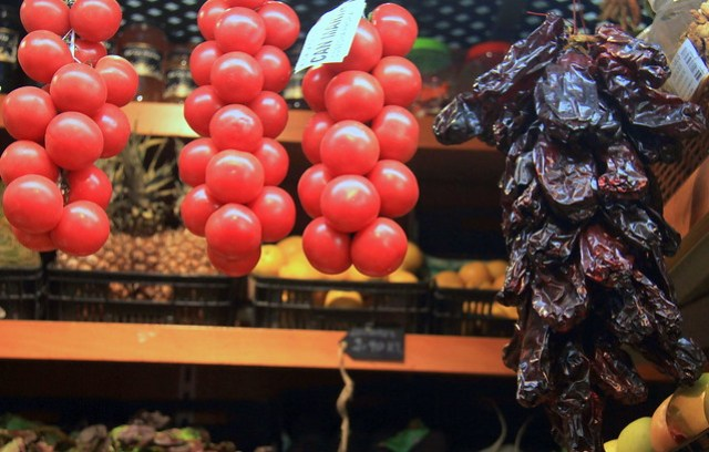 Spanish tomatoes and sun dried pepper on display at Girona Food Market