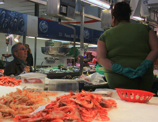 Man buying fish at Girona Food Market
