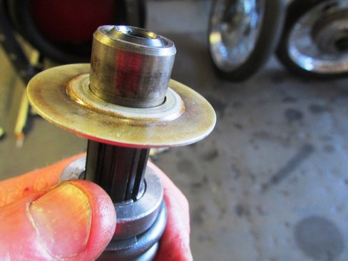 Input Shaft Rear Ball Bearing Shield Sits On Top of Top Hat Sleeve