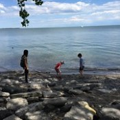 Throwing stones in Lake Ontario (L-R: Maya, Arthur, James). Lovely day on the waterfront!