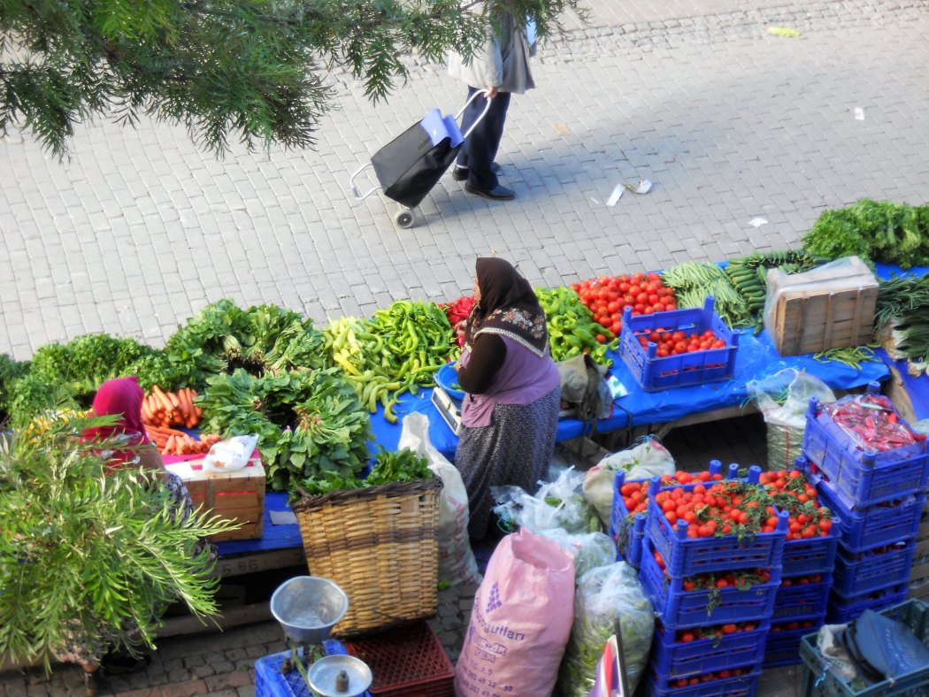 A village woman selling her bounty at the market