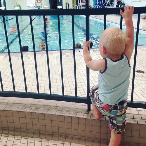 This little social butterfly loves swimming lessons as much as his brothers that are actually in them! He loves schmoozing with the parents and siblings that watch too!