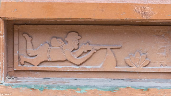 Carving a soldier with his gun in the temple