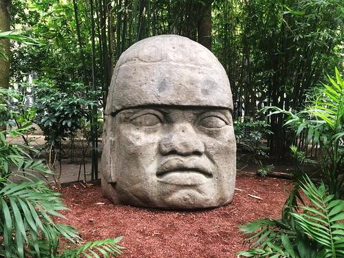 Olmec head stone carving