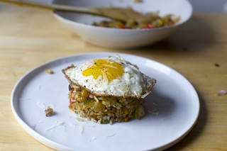 fried rice with zucchini, tomatoes and parmesan