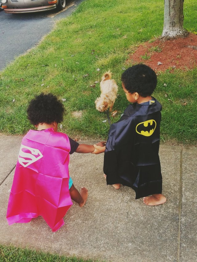Even Superheroes need to walk the dog and hold hands!