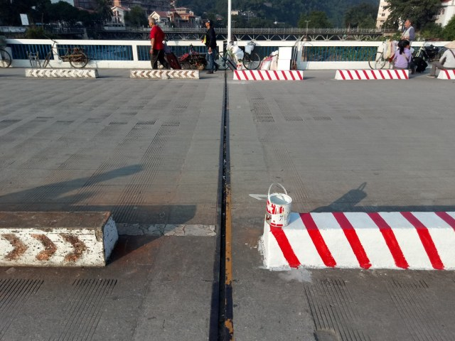 The mid-point on the bridge, Vietnam is freshly painted