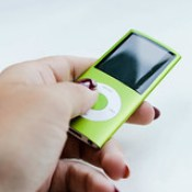 Woman's hand holding green ipod.