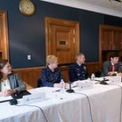 Policy Advisor Paul Massaro with panelists Julia Gourley, Iina Peltonen, Rear Admiral Michael McAllister, Melanie Bahnke, and Mark Smith.
