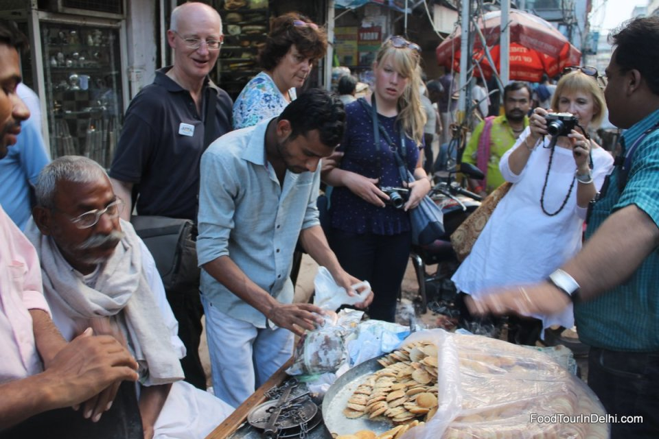 Tasting traditional Indian cookies from a street vendor